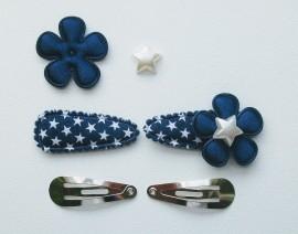 Zelf haarspeldjes maken donkerblauw met witte sterren van 3.5 cm.