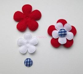 Bloemen van vilt rood wit blauw.