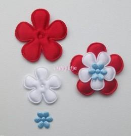 Set satijnen bloemen rood, wit en blauw.